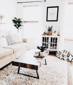 1557dc18619 Beautiful white living room wit white couch and wood coffee table.