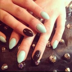 Mint and black stiletto nails