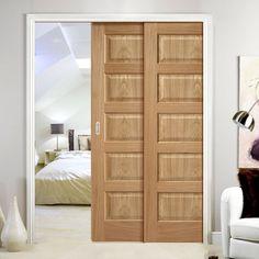 Twin Telescopic Pocket Contemporary 5P Oak Veneered Doors - Prefinished.    #contemporarydoors  #oakdoors #moderndoors  #hiddendoors  #pocketdoors  #door #doors #slidingddoors