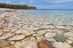 Bruce Peninsula National Park, Canada. In the heart of a World Biosphere Reserve, the 'Bruce' is place of global significance. Thousands of visitors come each year to experience the massive, rugged cliffs of the park, inhabited by thousand year old cedar trees, overhanging the crystal clear waters of Georgian Bay. The park is comprised of an incredible array of habitats from rare limestone to dense forests and clean lakes.