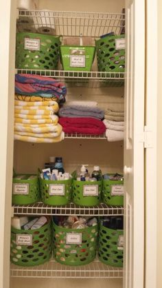 My guest bathroom closet. Baskets are from Dollar Tree.