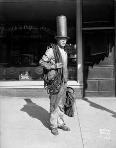 George Stahl, chimney sweep, in stovepipe hat, photographed outside the London Hat Cleaner 1931.