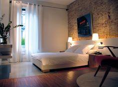 Love the brick accent wall and the split wood/asphalt floors