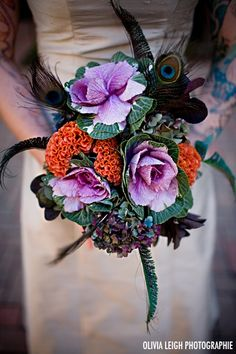 Ornamental kale (cabbage) in bouquets, centerpieces, arrangements. Big bang for your buck. I also love the feathers and burnt orange celosia in this arrangement