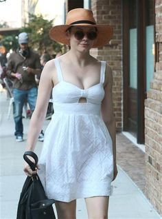 Rose McGowan looked feminine and light in an eyelet-embellished white summer dress with a wide-brimmed hat and black bag while out and about in New York City on Aug. 9, 2015.