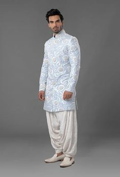 Sherwani is featured in light blue colour in raw silk fabric with white thread embroidery. Kurta is of spun fabric and salwar is made of ivory color chikan fabric. Indian Wedding Suits Men, Sherwani For Men Wedding, Sherwani Groom, Indian Groom Wear, Indian Wedding Outfits, Mens Sherwani, Bridal Outfits, New Dress Design Indian, Groom Wedding Dress