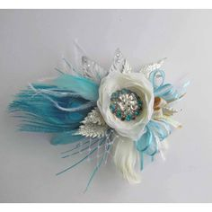 Gatsby Corsage in Ivory, Teal, Silver & Gold for your Prom/ Formal... ($58) ❤ liked on Polyvore featuring jewelry, silver prom jewelry, ivory jewelry, bow jewelry, leaf jewelry and silver gold jewelry