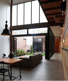 Love the contrast of polished concrete floor and the wooden walls and comfy furniture.
