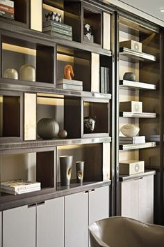 A very chic and clean custom wall unit with perfect lighting and a sleek and zen mix of special interest books and glass objects. Cabinet Design, Modern Interior, Shelves, Luxury Interior, Interior, Home Decor, Shelving Design, House Interior, Office Interiors