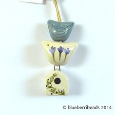 Handmade ceramic birdhouse in blue by blueberribeads on Etsy, £12.00
