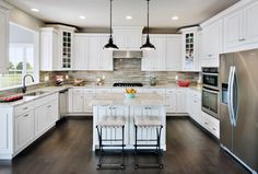 The white cabinets and dark floors were made for each other. (Toll Brothers High Pointe at St. Georges, DE)