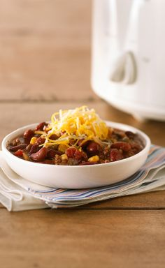 Slow-Cooker Hearty Beef Chili — Ground beef, beans and cheese provide a tasty foundation to this easy slow-cooker chili. Serve with sour cream or bacon bits for extra flavor and color.