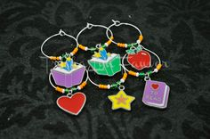 Teachers need a good drink after hours, AMIRIGHT?! These charms are perfect for parties to remember whose glass is whose! Each charm in this set of 6 is unique, helping party-goers identify their handled-beer or wine glass when using a set of identical glasses for your beverages. This set is perfect for after school cocktails.