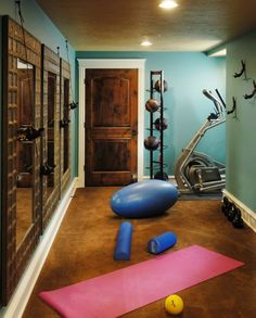 Compact home gym with a basketball organizer and lovely mirrors