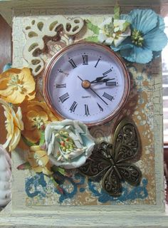 Wooden clock for my mom. They are painted with acrylics, slightly weathered, and decorated with paper and metal decorations