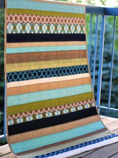 A Modern Meadow stripe quilt for a baby boy
