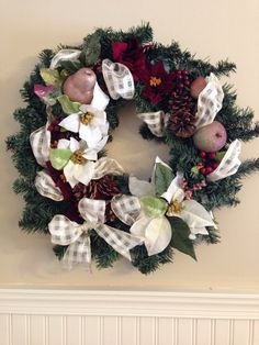 18-inch wreath with flowers, fruit and pine cones. Brightens the season.