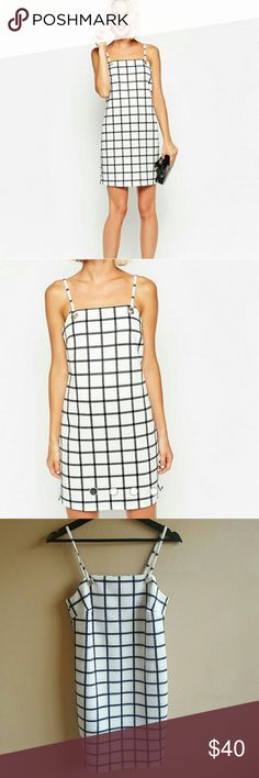 ASOS Black & White Blocked Pinafore Dress UK 8 New with tags! White ASOS dress with black grid pattern. Lined. Perfect dress for spring and summer.  US 4 / EU 36 / UK 8 ASOS Dresses Mini