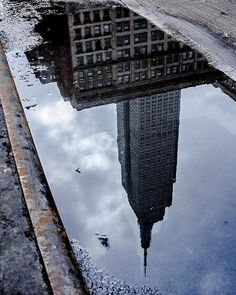 """An awesome Virtual Reality pic! """"... and besides"""" she thought """"... if hearts reflected as honestly as wet city streets maybe we'd all be reduced to puddles. """" .  #reflections in #concrete #puddles.. The  #remnants of a #winterstorm continue to settle in the creases of the #nyc #streets . And I wonder ... does the #water from the melted snow still hold on to the powerful energy it arrived with? Is it latent there somewhere? Or is it truly transformed ... passive gentle and calm before it…"""