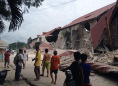 People walk past damaged Church of San Pedro in Loboc, Bohol Province, Phillipines after a earthquake struck the region At least 82 are dead and many churches damaged. Alex Johnson NBC News/Robert Michael Poole AFP-Getty Bohol, Philippines Earthquake, Michael Poole, Top Stories Today, United States Geological Survey, Visayas, Severe Storms, Asia News, Tear Down
