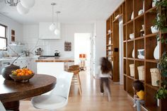Inside a light-filled renovated kitchen that includes white tiles, open shelving, and a bubblegum-pink sink. Rustic Desk, Rustic Chair, Rustic Office, Kitchen Rustic, Rustic Shelves, Rustic Farmhouse, Modern Kitchen Renovation, Kitchen Remodel, Home Decor Kitchen