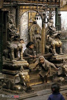 Vintage Nepal ~ Rare Old Pictures, Videos and Arts of Nepal   Playing by the temple: Young children play on an altar at the entrance of the temple dedicated to Hinduism and Buddhism.  Date Photographed: 1970 | Contributor/Credit: Marc Wolstenholme (Donor Member) | Collection: Vintage Nepal