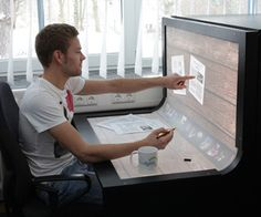 The multi-touch desk environment allows the user to interact with the entire surface using direct manipulation and multi-touch gestures.
