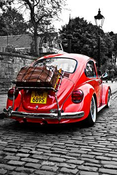 A beautifully restored classic Volkswagen Beetle on a journey.