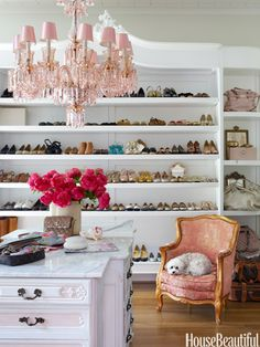 """Romantic Closet--A custom-made """"stretched"""" vintage armoire was created to hold the shoes.  The pink chandelier adds a touch of romance to the dressing room."""