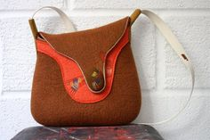 Hand felted wool cross body bag with stitched abstract ornament and cotton strap