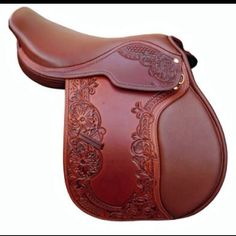 Would love to make a Hand Carved English Saddle in dark brown or chocolate with brass hardware!