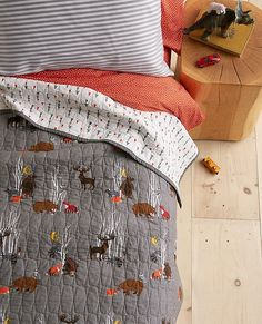 Our reversible cotton keeper quilt keeps the spirit of the Swedish forest alive and well with one side of woodland critters that reverses to a modern tree print—making the bed is double easy! Certified by Oeko-Tex® Standard 100, it's crafted from cotton with cotton fill for year-round just-right comfort. <br>• Soft 100% cotton <br>• Pure cotton fill <br>• Fully reversible for every-way's-the-right-way bed making <br>• Woodland critter print reverses to modern tree print ...