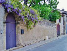 purple door with purple flowers.  glycine à la roque d'antheron | by de Provence et d'ailleurs