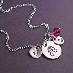 Sterling silver chain is available in 16, 18, 20, 24, and 30 inches. A small 1/2 inch stainless steel disc is engraved with ballet shoes, and is hanging from a sterling silver chain. **ALL CHARMS ARE