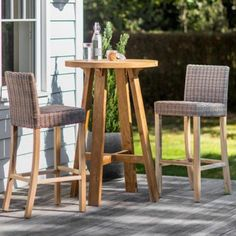 St Mawes Round Bar Table made from Reclaimed Teak with 2 Lymington Bar Stool made from PE Rattan in Garden