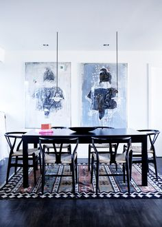 Source: Line Klein  I love this! Dark floors, black wishbone chairs, the balance of pendant lights & art, black & white. Perfect.