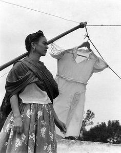 Frida Kahlo en la azotea con vestido secando, 1930s. by Manuel Álvarez Bravo