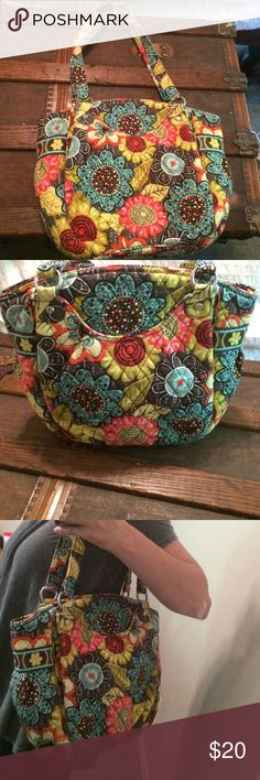 Vera Bradley Purse In perfect condition! Super cute purse with 2 pockets on each side of the front, one zippered pocket and a pouch in the main opening. Vera Bradley Bags Shoulder Bags