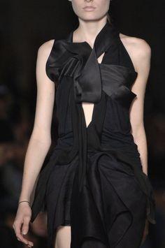 Black dress with fluid folds & twists, draped fashion details // Rick Owens Spring 2007