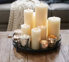 With a hint of Art Deco design, our rustic tray is an artistic piece for a grouping of pillars and votives – and a few natural objects for added drama. Romantic Candles, Diy Candles, Pillar Candles, Candle Centerpieces For Home, Candle Decorations, Bathroom Candles, Design Candles, Candle Arrangements, White Candles