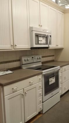 Clean lines and bright cabinetry ugh tens up kitchen - too bright