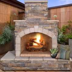 Perfect outdoor fireplace for my backyard! I've always wanted one of these! - outdoor firepace - fireplace - backyard - deck - patio - fire pit - propane fireplace - stone fireplace -sponsored