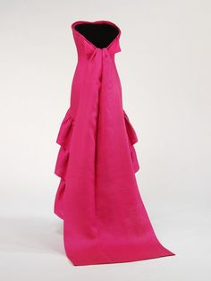 Evening dress  Place of origin: Paris, France (made)  Date: February 1961 (made)  Artist/Maker: Cristóbal Balenciaga, born 1895 - died 1972 (designer)  Materials and Techniques: Gazar, lined with silk, boned  Credit Line: Given by Mr Stavros Niarchos