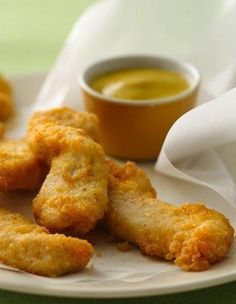 Gluten Free Ultimate Chicken Fingers chicken dipped in egg then bisquick/parmesean mixture
