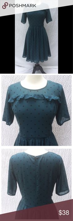 """New Eshakti Teal Polka Dot Fit Fare Dress L 14 New Eshakti dark teal polka dot crepe fit & flare dress. L 14 Measured flat: underarm to underarm: 39"""" Waist: 33"""" Length: 39 1/2"""" Sleeve: 11 1/2"""" Eshakti size guide for 14bust: 40"""" Ruffle at yoke & sleeves, seamed bodice, back hidden zipper. Seamed waist w/ center ruched pleated flared skirt. Side seam pockets. Polyester woven crepe, no stretch over polyester lining. Machine wash. New w/ cut out Eshakti tag to prevent returning to Eshakti…"""