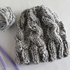 Knit this trendy chunky cable knit hat with Lion Brand Hometown USA or Wool-Ease Thick & Quick! Get the free knit pattern on Ravelry by Lula Louise DIY Design!