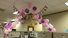 Office birthday cubicle decor. 30 minutes.  Fishing string balloon arch...tension tight using paper clips