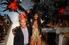 Designer Red Carter and a model walk the runway at the Red Carter show during Mercedes-Benz Fashion Week Swim 2013 at The Raleigh on July 22, 2012 in Miami Beach, Florida.