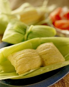 Humita is a native American dish from pre-Hispanic times, and a traditional food in Chile. Humitas are prepared with fresh corn, onion, basil, and butter or lard. They are wrapped in corn husks and baked or boiled. The humitas are kept together during cooking with thread or twine.