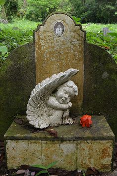 baby angel, Bukit Brown Cemetery, Singapore  (not Victorian, but such a sad picture of a little one's grave)